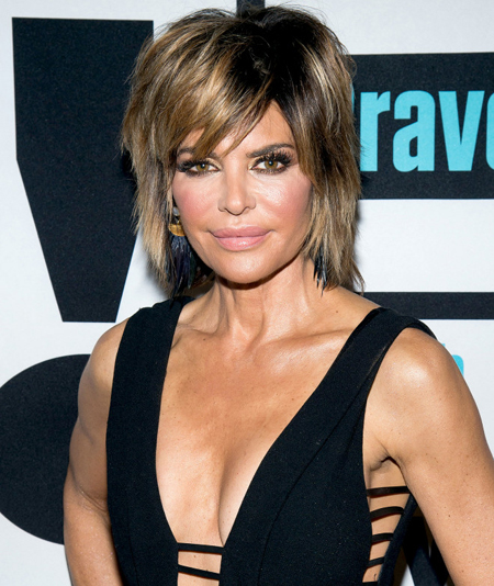Lisa Rinna plastic surgery - The actress got lip fillers and breast augmentation surgery.